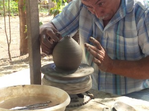 41 Man Making Pottery